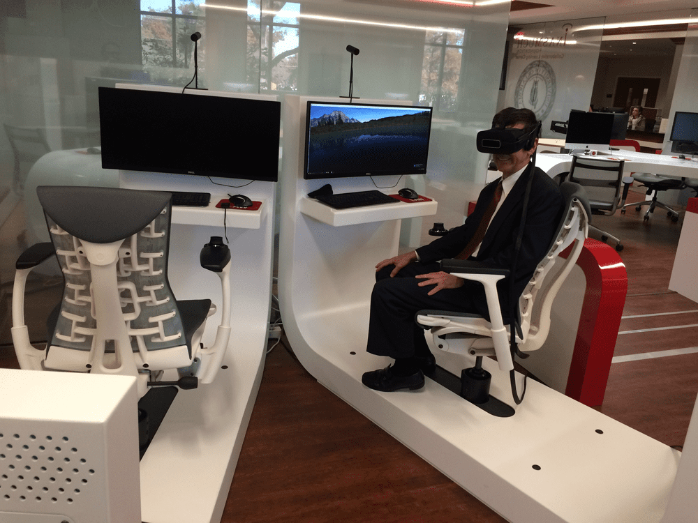 Mr. Dancy using the virtual reality equipment at The University of Oklahoma College of Law library