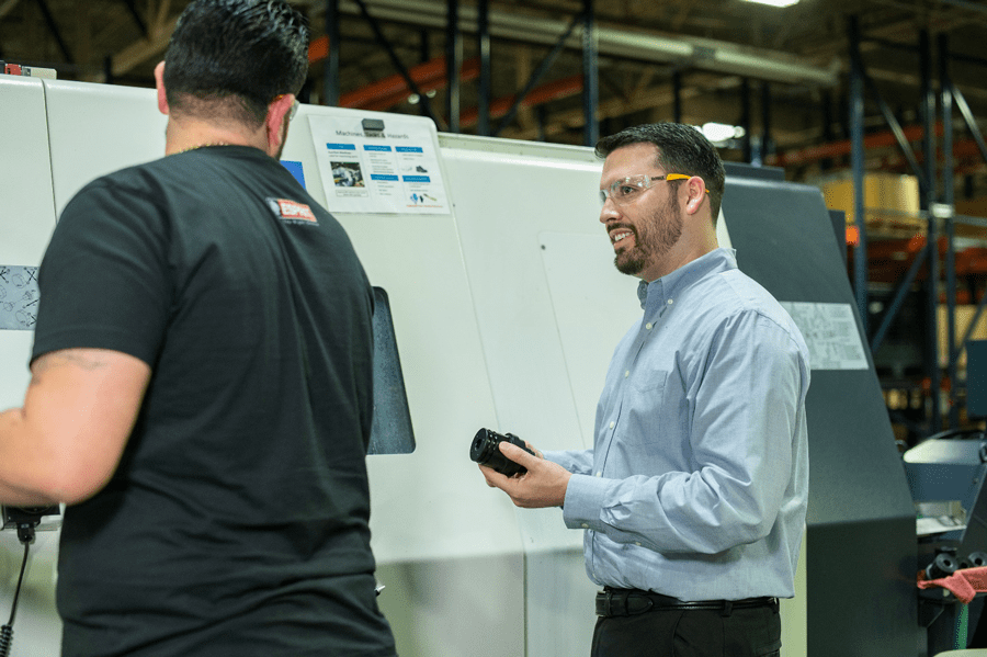 Programmer Alejandro Perez (left) and manufacturing manager Justin Henry (right), working on the Citizen Miyano ABX-51TH3.
