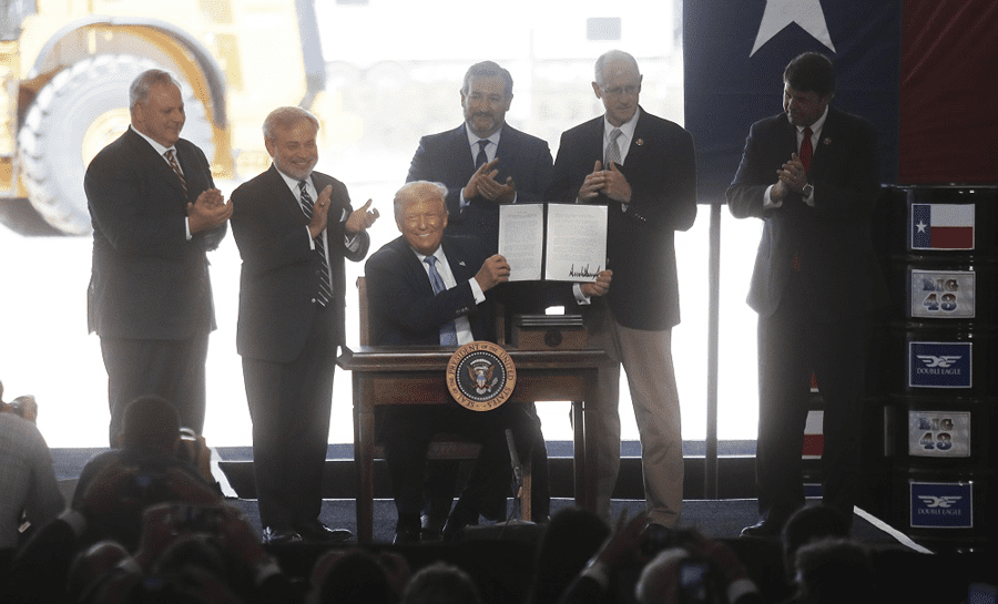 President Donald J. Trump signs oil and gas permits at the Double Eagle Energy Rig in Midland, Texas, July 29, 2020. Photo courtesy of Shutterstock/Mark Rogers