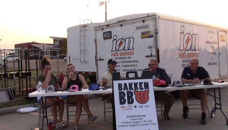 """Living the Crude Life live recording session at the Bakken BBQ in Dickinson, ND. Host Jason Spiess (middle) moderates the discussion of """"How Oil and Gas Builds Culture and Communities"""" with the co-founders of the Bakken BBQ, Jackie Jenkin (left) and Tiffany Steiner (middle left); Mayor of Bismarck (ND) Steve Bakken (middle right), and Patrick Bertagnoli, community enhancement director, City of Watford City (right)."""